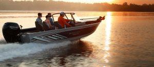 Smoker Craft fishing boat running at sunset